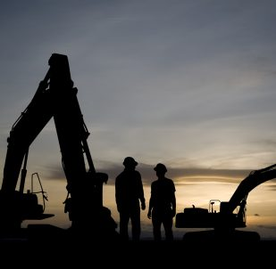 Excavators at Dawn